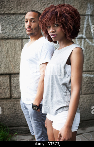 Portrait of serious young couple looking at camera - Stock Photo