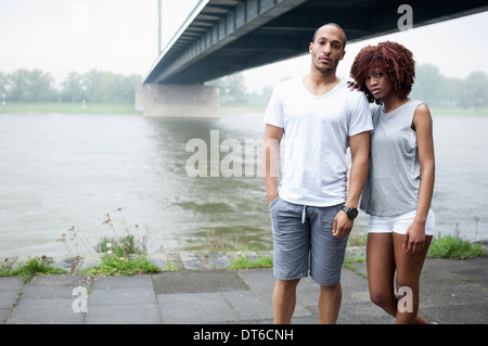 Portrait of young couple by bridge, Dusseldorf, Germany - Stock Photo