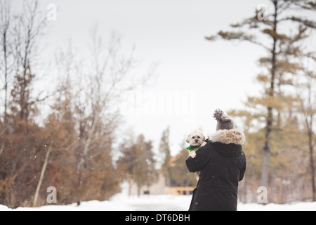 Woman with pet dog outdoors - Stock Photo