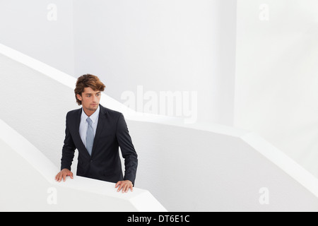 Young businessman waiting on stairs - Stock Photo