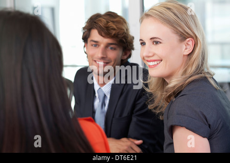 Young business colleagues having team meeting in office - Stock Photo