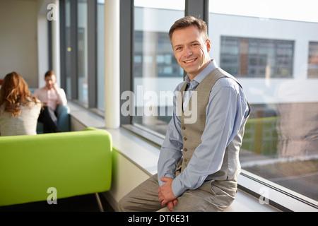 Portrait of mature man wearing waistcoat - Stock Photo