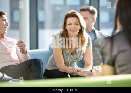 Portrait of business colleagues in meeting - Stock Photo