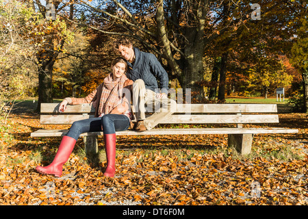Couple sitting on bench - Stock Photo