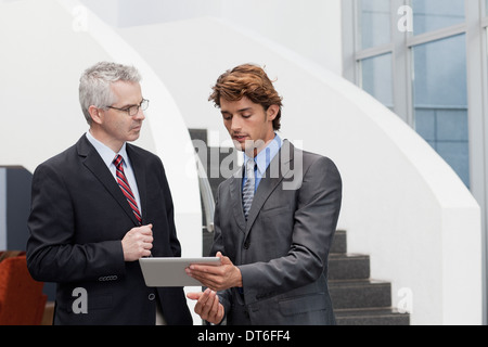 Business colleagues chatting in office atrium