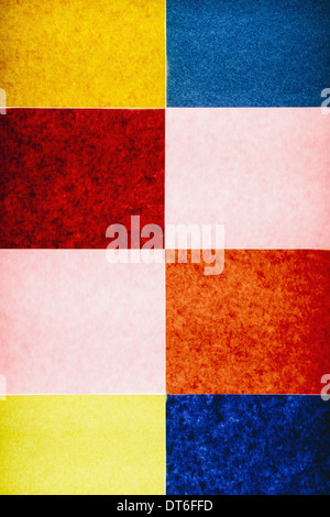 Multi-colored pieces of recycled construction paper. A pattern of rectangles, in different colours, above a light - Stock Photo