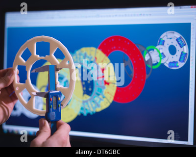 Close up of engineer designing industrial clutch using CAD software - Stock Photo