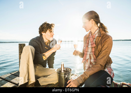 Couple toasting with champagne, Lake Starnberg, Bavaria, Germany - Stock Photo