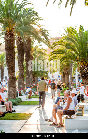 Sunset on the promenade by the sea - Stock Photo