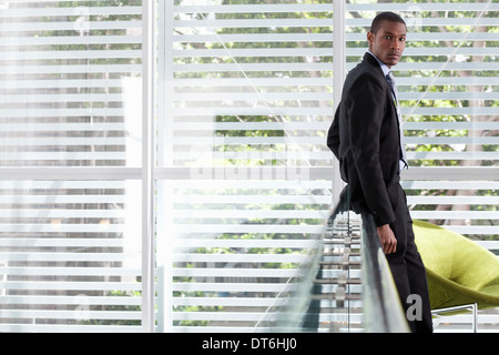 Portrait of mid adult businessman on office balcony - Stock Photo