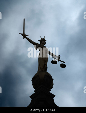 Old Bailey Statue of Lady Justice, Silhouetted Against a Stormy Sky. Central Criminal Court, London, United Kingdom. - Stock Photo
