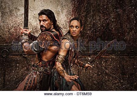 MANU BENNETT & CYNTHIA ADDAI-ROBINSON SPARTACUS: BLOOD AND SAND (2010) - Stock Photo