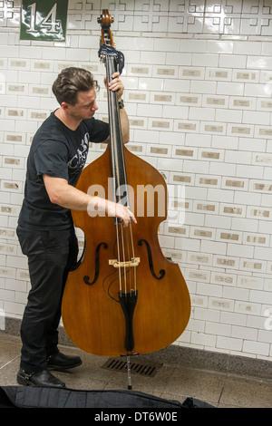 Upright bass subway musician - Stock Photo
