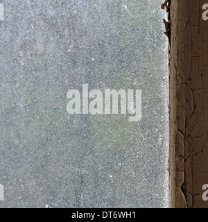 Dusty glass peeling wooden window frame abstract grungy background. - Stock Photo