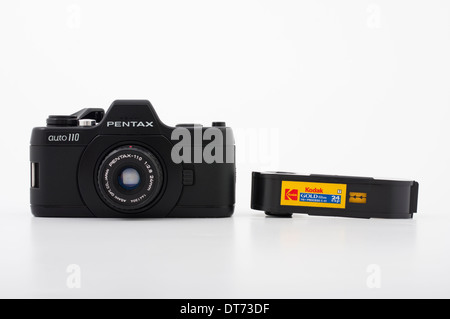 Pentax auto 110 film SLR camera using compact 110 film ( Kodak ) - Stock Photo