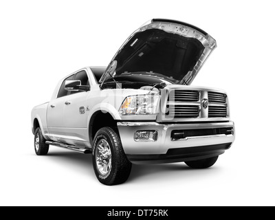 White 2012 Dodge RAM 1500 Laramie Longhorn pickup truck isolated on white background with clipping path - Stock Photo