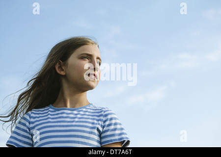 Portrait of a confident and happy nine year old girl outdoors King County Washington USA - Stock Photo