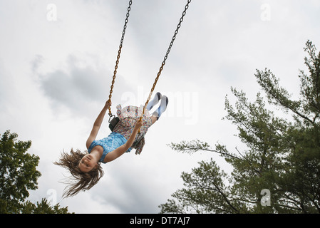 A girl on a rope swing high in the air Woodstock New York USA USA - Stock Photo