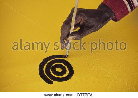 Aboriginal artist at work Central Desert Australia Central Desert Australia - Stock Photo