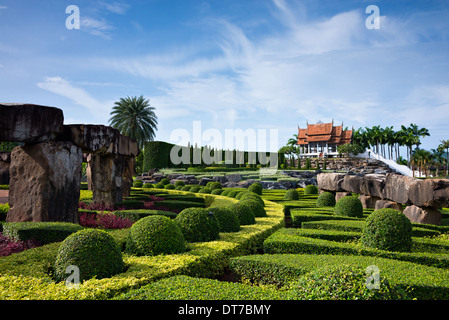 A beautiful scenic view of aThai garden with A Thai gazebo in the distant at Nong Nooch Tropical Garden, Thailand - Stock Photo