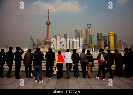 people Pudong skyline Oriental Pearl Tower the Shanghai World Financial Center Jin Mao Tower viewed from over the - Stock Photo