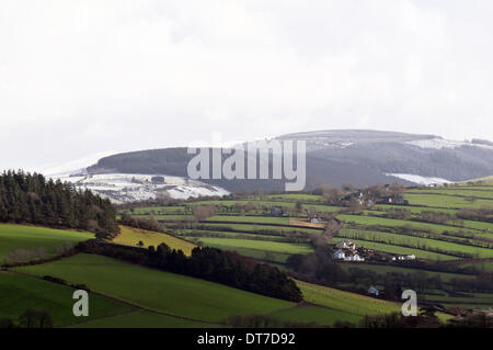 Aberystwyth, Wales, UK. 11th February 2014. - Heavy wintry showers bring snow to the tops of the Cambrian Mountains - Stock Photo