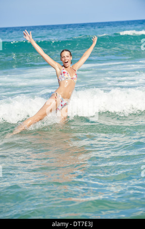 young, pretty, sportive woman in bikini in the water (model-released) - Stock Photo