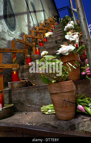 Duisburg, Germany. 10th Feb, 2014. Candles, flowers and commemorative stones commemorate the people who died in - Stock Photo
