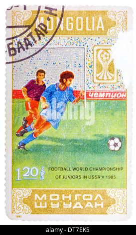 MONGOLIA - CIRCA 1985: Stamp printed in Mongolia shows Football world championship of juniors in USSR 1985, circa - Stock Photo
