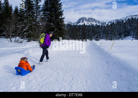 Father and son in the snow. - Stock Photo