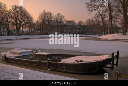 Winter season in Holland. A soft pastel sunset on Witte Singel Canal in the city of Leiden, South Holland, The Netherlands. - Stock Photo