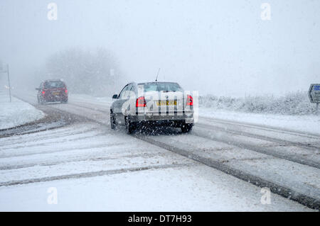 Peak District, Derbyshire, UK. 11th Feb, 2014. Snow storms and heavy rain sweep across the Peak District. Making - Stock Photo