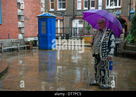 Pearly King with an umbrella arriving for the London Pearly Kings and Queens second Harvest Festival, St Paul's - Stock Photo