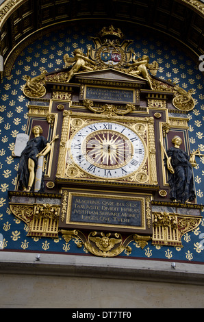 Paris's oldest clock on the north-east corner of the façade of the Palais de Justice building , Paris, France. - Stock Photo