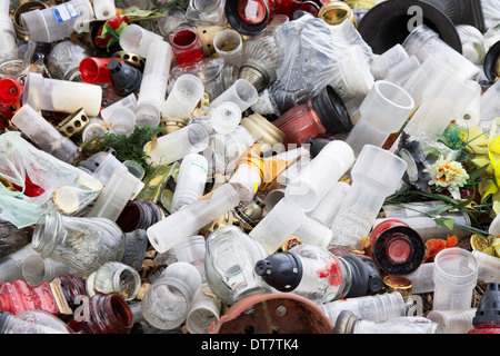 Plastic and glass rubbish on cementery - Stock Photo