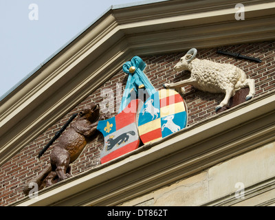 Family coat of arms, with beaver and goat, on a historic building in Dordrecht, the Netherlands, one of the oldest - Stock Photo