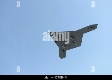 An X-47B unmanned combat air system in flight. - Stock Photo