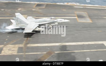 Gulf of Oman, June 15, 2013 - An F/A-18C Hornet lands on the flight deck of the aircraft carrier USS Nimitz. - Stock Photo
