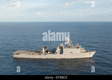 Amphibious dock landing ship USS Pearl Harbor transits the Pacific Ocean. - Stock Photo