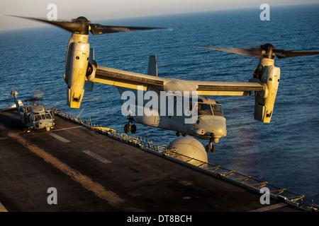 Red Sea, July 13, 2013 - A U.S. Marine Corps MV-22B Osprey lands on the amphibious assault ship USS Kearsarge. - Stock Photo