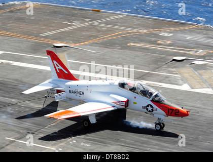 A T-45C Goshawk lands on the flight deck of USS Ronald Reagan. - Stock Photo