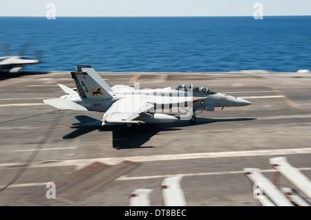 Atlantic Ocean, August 5, 2013 - An FA-18F Super Hornet lands aboard the aircraft carrier USS George H.W. Bush. - Stock Photo