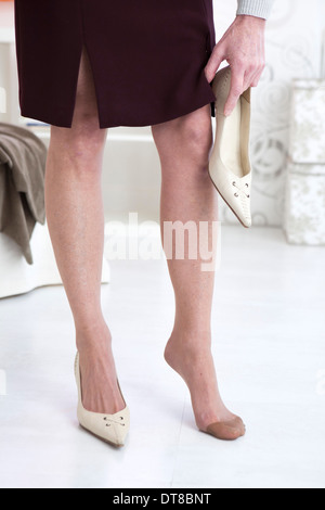 FOOT PAIN IN A SENIOR - Stock Photo