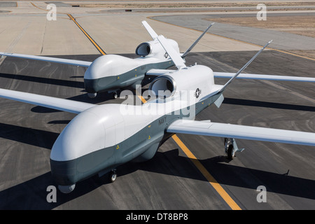 Two MQ-4C Triton unmanned aerial vehicles on the tarmac. - Stock Photo