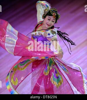 Paris, France. 11th Feb, 2014. 74-year-old Chinese dancer Chen Ailian performs at the headquarters of the United - Stock Photo