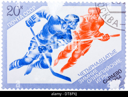 USSR - CIRCA 1984: Postage stamps printed in the USSR, shows Hockey in the XIV Olympic Winter Games in Sarajevo, - Stock Photo