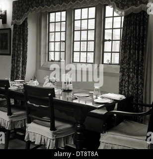 Historical picture from 1950s showing a dinning table in a restaurant. - Stock Photo