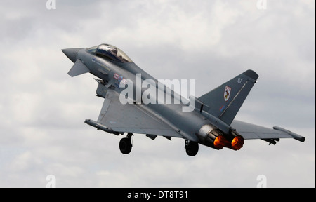 RAF Typhoon Jet fighter taking off with afterburner. - Stock Photo