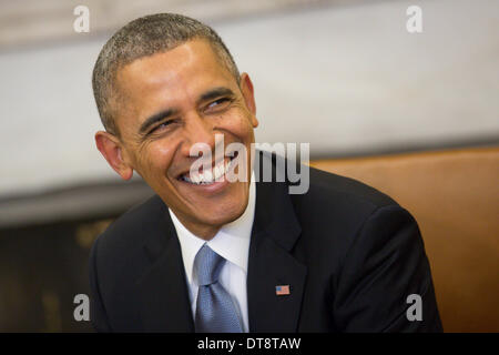 Washington DC, USA. 11th Feb, 2014. United States President Barack Obama smiles while meeting with President Francois - Stock Photo