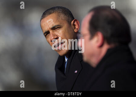Washington DC, USA. 11th Feb, 2014. United States President Barack Obama (L) speaks during an arrival ceremony with - Stock Photo